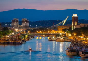 Pescara (Italy) - The view in the dusk from Ponte del Mare monumental bridge in the canal and port of Pescara city, Abruzzo region.