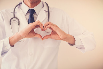 Doctor making his hands in heart shape, heart health,  health insurance concept