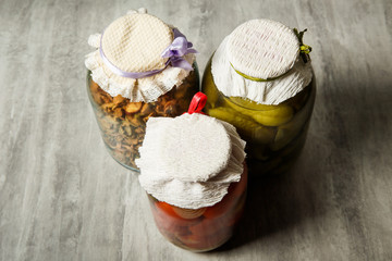 top view on glass jars with homemade canned vegetables