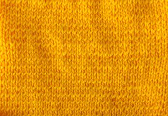 Background. Woolen yarn of bright orange color