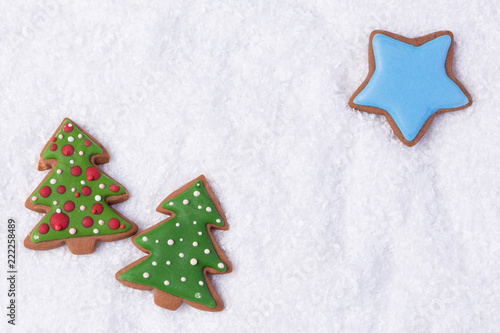 On A White Snowy Background Gingerbread In The Form Of A Tree And A