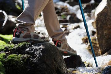 Female tourist  walking  on mountain rocky path