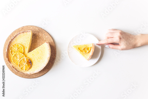 Lemon Tart With Dried Lemons As A Decoration And A Cut Piece In