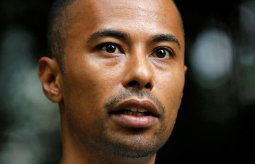 Biracial model Joe Oliver speaks during an interview with Reuters in Tokyo