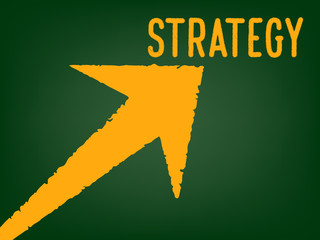 Strategy - Arrow with a text on chalk board -  Concept of Business Strategy