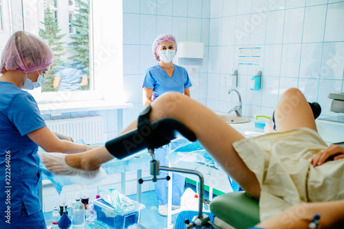 Female gynecologist finished the procedure, assistant