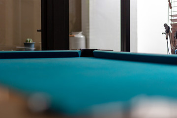 Empty snooker table and corner view with hole. Empty billiard pool table with blue cloth