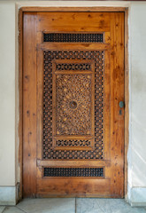 Wooden engraved door with geometrical engraved patterns
