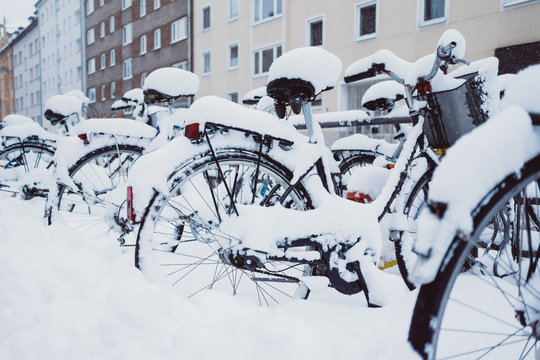 Bicycles in snow near houses