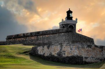 Fototapeten Karibik Sunset view of ancient Fort San Felipe Del Morro in San Juan, Puerto Rico
