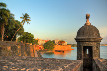 Acrylic Prints Caribbean Beautiful summer afternoon at the outer wall with sentry box of fort San Felipe del Morro in old San Juan in Puerto Rico