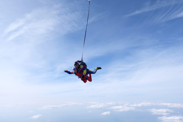 Skydiving. Tandem jump is with asian girl.