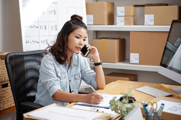 Portrait of a pretty woman phone talking to clients for shipping
