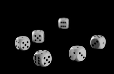 White gambling dice isolated on black background