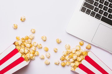 Glasses and popcorn with keyboard on a white background top view