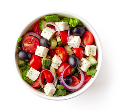 Greek salad in take away bowl on white background; from above