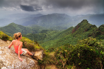 Adventurous young woman on top of the beautiful jungle of the El Yunque national forest in Puerto Rico