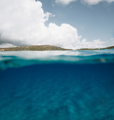 Split Photo Half Underwater with Clear Blue Sky and Mountains in Sardinia - body copy