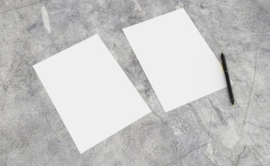 3D render of clean paper sheet. Template for your design. On concrete table.