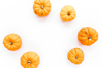 Orange pumpkins Halloween isolated on white background. Flat lay, top view. Autumn minimal concept.
