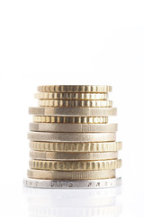 money and finance concept: group of coin pile and isolated on white background with copy space