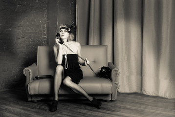 Красивая молодая девушка в образе 30 годов 20 века.