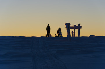 silhouettes of people on winter landscape