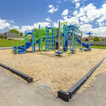 Colorful children playground with view of houses