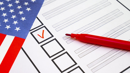 Voting in paper ballot by red pencil in United States of America wirh USA flag