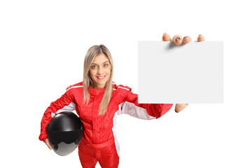 Female race driver holding a small white banner