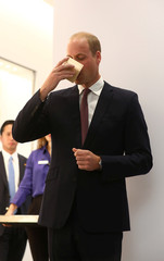 Britain's Prince William takes a sip of sake at the official opening of Japan House in London