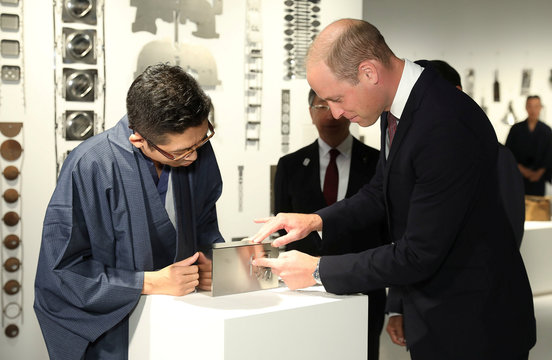 Britain's Prince William is shown a designed piece of 'magic metal' in which shapes seem to disappear by Ritsu Yamanda at the official opening of Japan House in London