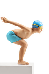Little boy swimmer ready to jump