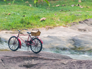Red bicycle on stone