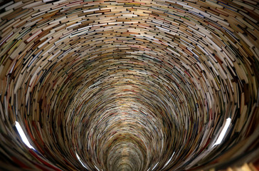 Books piled up at the entrance of Municipal Library of Prague are reflected in a mirror in Prague