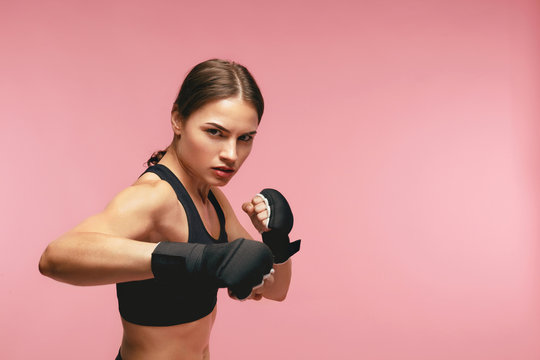 Female Boxer. Sportswoman Training In Boxing Bandages