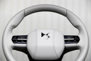 A logo is seen on a model of leather covered steering wheel used for the conception of the new DS 3 Crossback SUV presented at PSA's DS Brand Automotive Design Network centre in Velizy