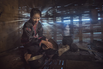Laos village women cooking in traditional kitchen on the morning.