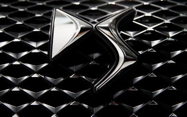 A DS logo is seen on a new DS 3 Crossback SUV car during a presentation at PSA's DS Brand Automotive Design Network centre in Velizy