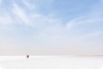 Couple walking in the Danakil Depression, ethiopia