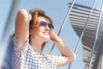 Elegant business woman wearing sunglasses  at hot summer day in the city