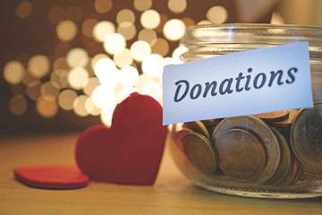 Donation money jar with blurred lights