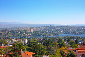 VILLA CARLOS PAZ, CORDOBA, ARGENTINA - APRIL 11, 2009: Panoramic view from the top of a hill of the landscape of Carlos Paz Town in a sunny day.