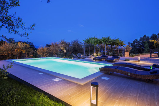 Holiday home with swimming pool at night
