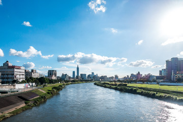 Serenity cityscape with skyscraper and river in Taipei, Taiwan.