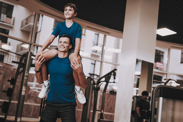Happy Father and Son Have Fun in Modern Sport Club