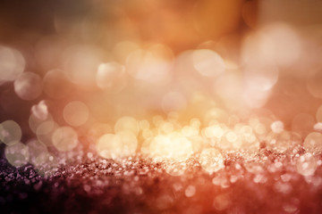 Abstract gold copper glittering bokeh background