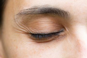Wrinkles on close eye