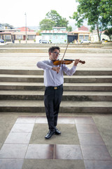 man playing violin in the square