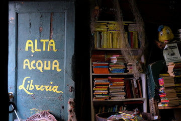 "Books are piled up at the entrance of the ""Acqua Alta"" bookstore in Venice"